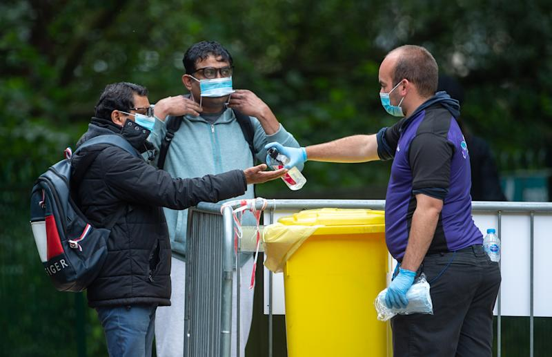 Members of the public sanitize their hands as they arrive at a Covid-19 testing centre in Spinney Hill Park in Leicester, where localised coronavirus lockdown restrictions have been in place since June 29, with non-essential shops ordered to close and people urged not to travel in or out of the area. Health Secretary Matt Hancock is due to decide whether to make changes to Leicester's lockdown after examining the latest coronavirus data. (Photo by Joe Giddens/PA Images via Getty Images)