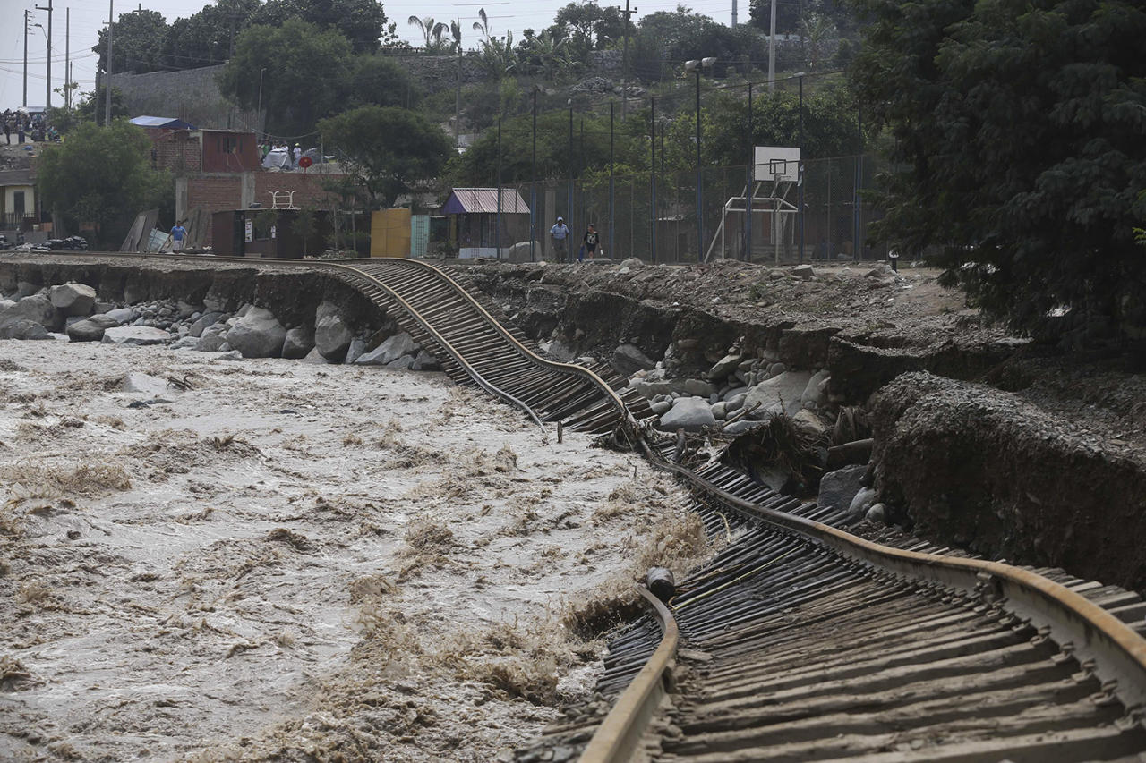 <p>Train tracks lay destroyed in a flooded river in the Chosica district of Lima, Peru, Sunday, March 19, 2017. Intense rains and mudslides over the past three days have wrought havoc around the Andean nation and caught residents in Lima, a desert city of 10 million where it almost never rains, by surprise. (Martin Mejia/AP) </p>