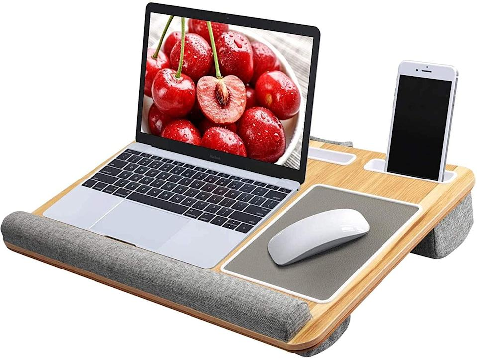 <p>Work from home gets a lot more comfy with this <span>Lap Desk</span> ($60).</p>
