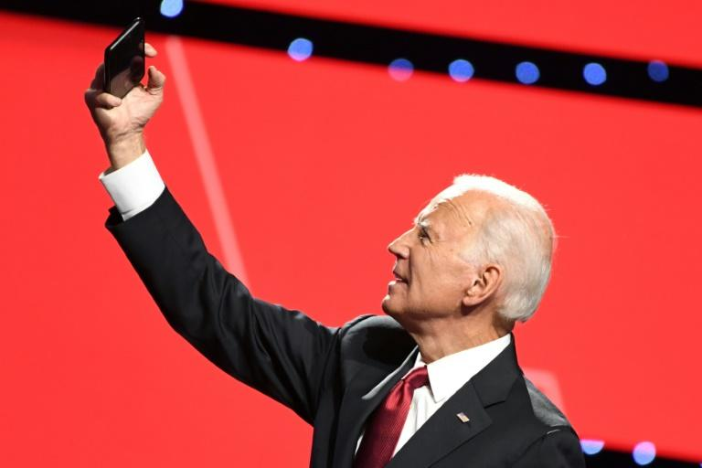 Democratic presidential hopeful Joe Biden, the former US vice president, takes a selfie with supporters after the fourth Democratic primary debate of the 2020 campaign season