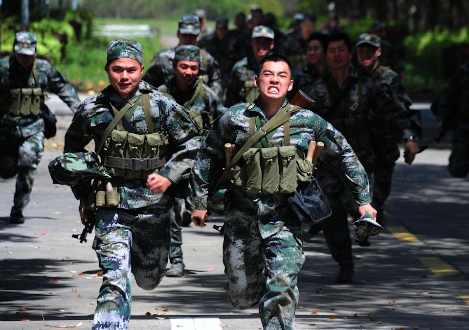 Officers and soldiers carry out military training in Taicang City, Jiangsu, China. Photo: Getty
