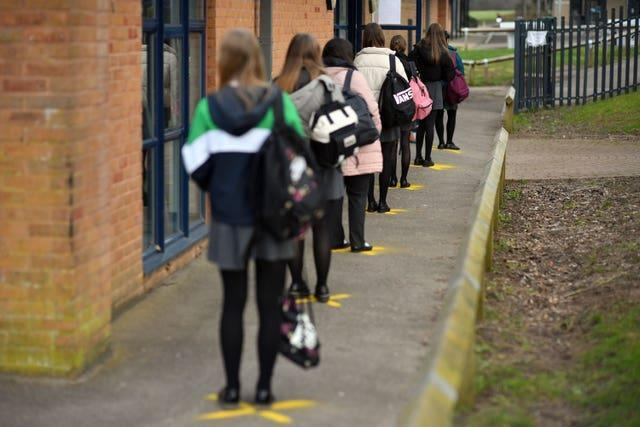 Pupils queuing to take a lateral flow test at Archway School in Stroud in Gloucestershire (Ben Birchall/PA)