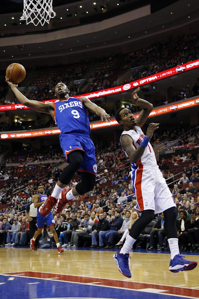 Philadelphia 76ers' James Anderson, left, goes up to shoot against Detroit Pistons' Brandon Jennings during the first half of an NBA basketball game on Saturday, March 29, 2014, in Philadelphia. (AP Photo/Matt Slocum)
