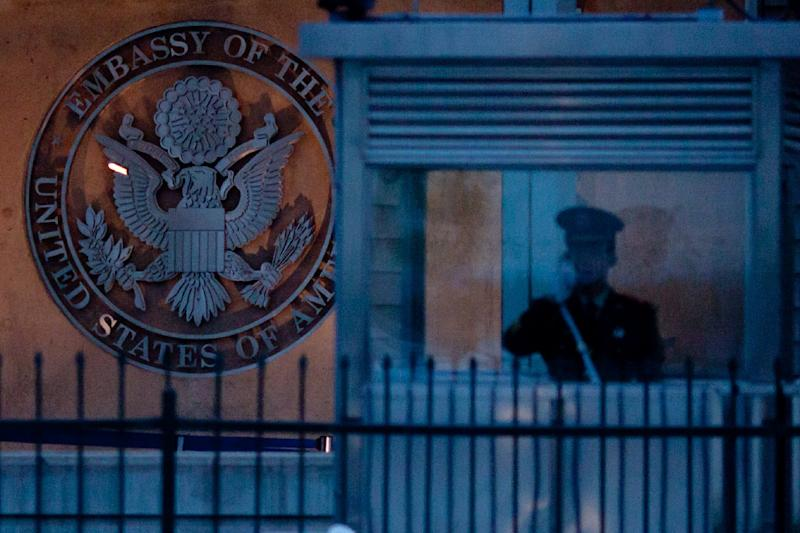 A paramilitary guard is pictured in a booth outside the US embassy in Beijing (AFP Photo/Ed Jones)