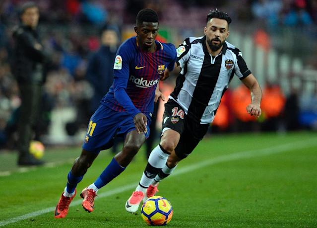 Barcelona's Ousmane Dembele (left) in action against Levante during a Spanish league match at the Camp Nou stadium on January 7, 2018 (AFP Photo/Josep LAGO)