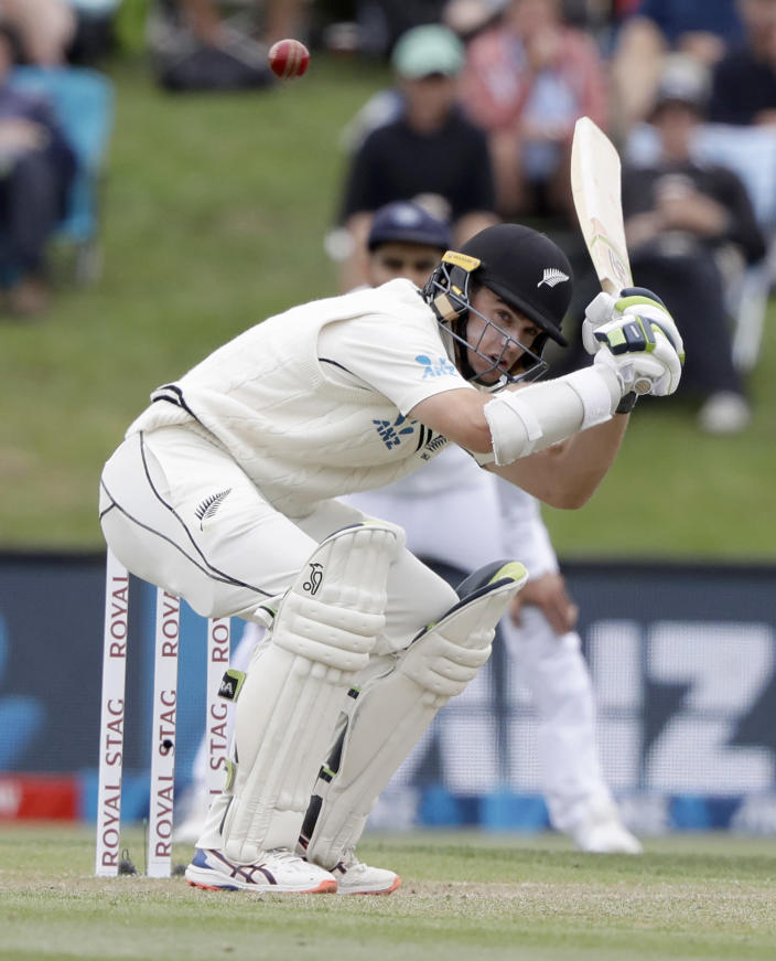 New Zealand's Tom Latham ducks to avoid a bouncer while batting during play on day three of the second cricket test between New Zealand and India at Hagley Oval in Christchurch, New Zealand, Monday, March 2, 2020. (AP Photo/Mark Baker)