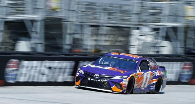 "<a class=""link rapid-noclick-resp"" href=""/nascar/sprint/drivers/1283/"" data-ylk=""slk:Denny Hamlin"">Denny Hamlin</a> finished 14th after making a green-flag pit stop for a loose wheel on Monday. (AP Photo/Wade Payne)"