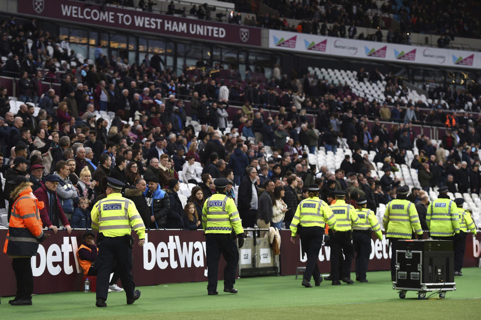 Police secure the area after a pitch invader ran onto the pitch during the English Premier League soccer match between Burnley and West Ham at the Olympic London Stadium in London, Saturday, March 10, 2018. (Daniel Hambury/PA via AP)