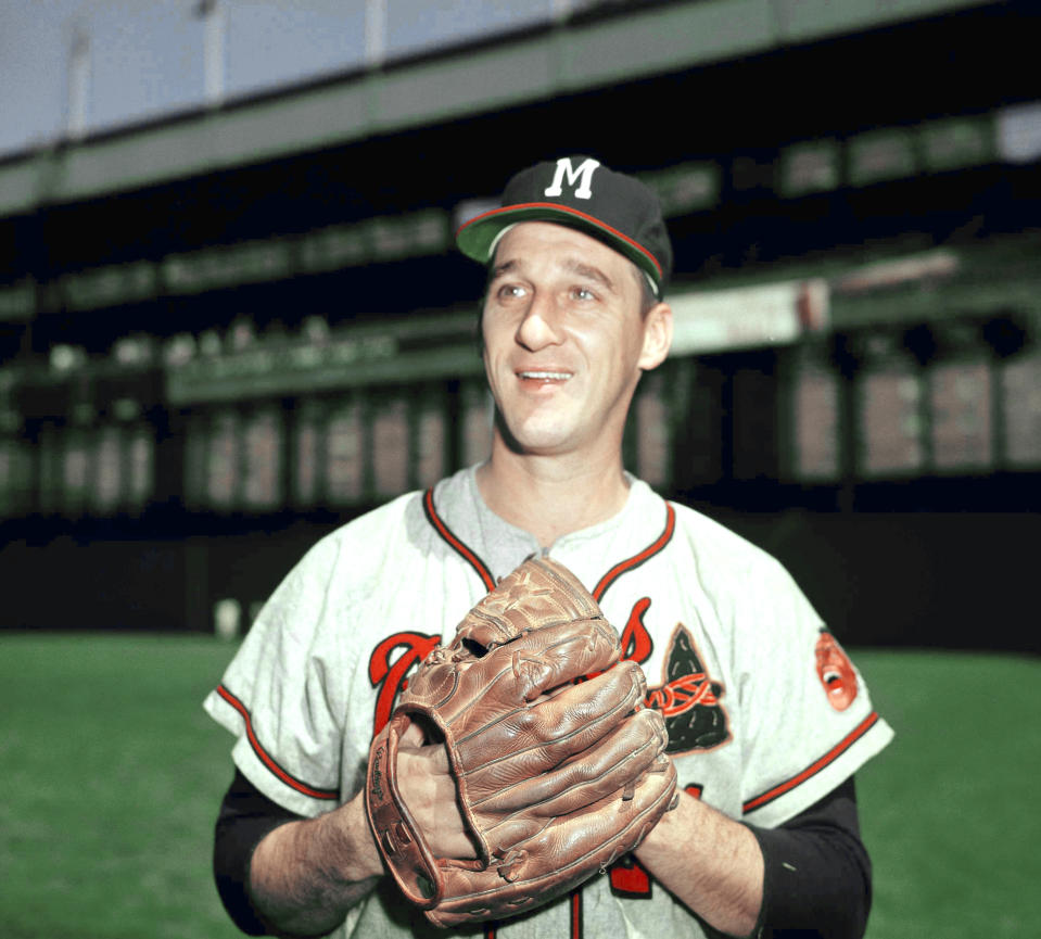 Warren Spahn, with glove in hand, pitcher for the Milwaukee Braves baseball team in March 1958. Location unknown. (AP Photo)