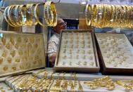 A Palestinian jeweler is seen inside his shop at the gold market in Gaza City