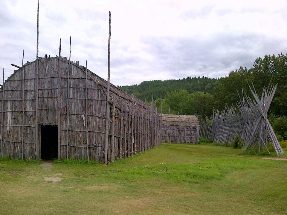 Image of an Iroquois longhouse, a building constructed from wood