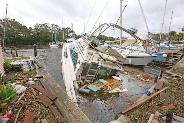 <p><strong>Palm Shores</strong><br>One of eight sunken boats at Sundance Marine in Palm Shores, Fla. on Sept. 11, 2017. Debris from sunken boats and docks washed over the seawall onto the land as Hurricane Irma winds blew from the east. (Photo: Red Huber/Orlando Sentinel/TNS via Getty Images) </p>