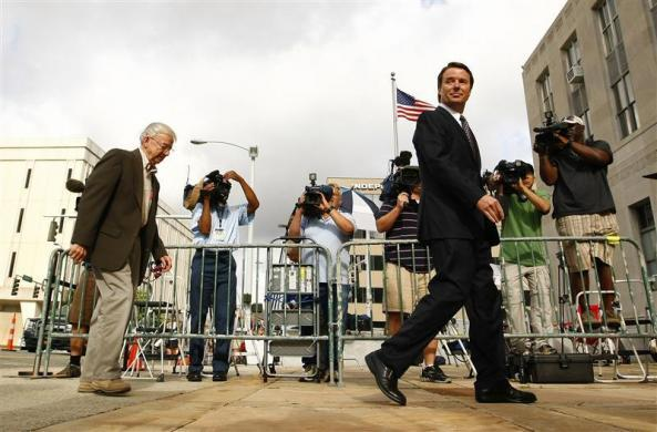 Former U.S. Senator John Edwards arrives with his father Wallace (L) at the federal court house in Greensboro, North Carolina May 29, 2012.