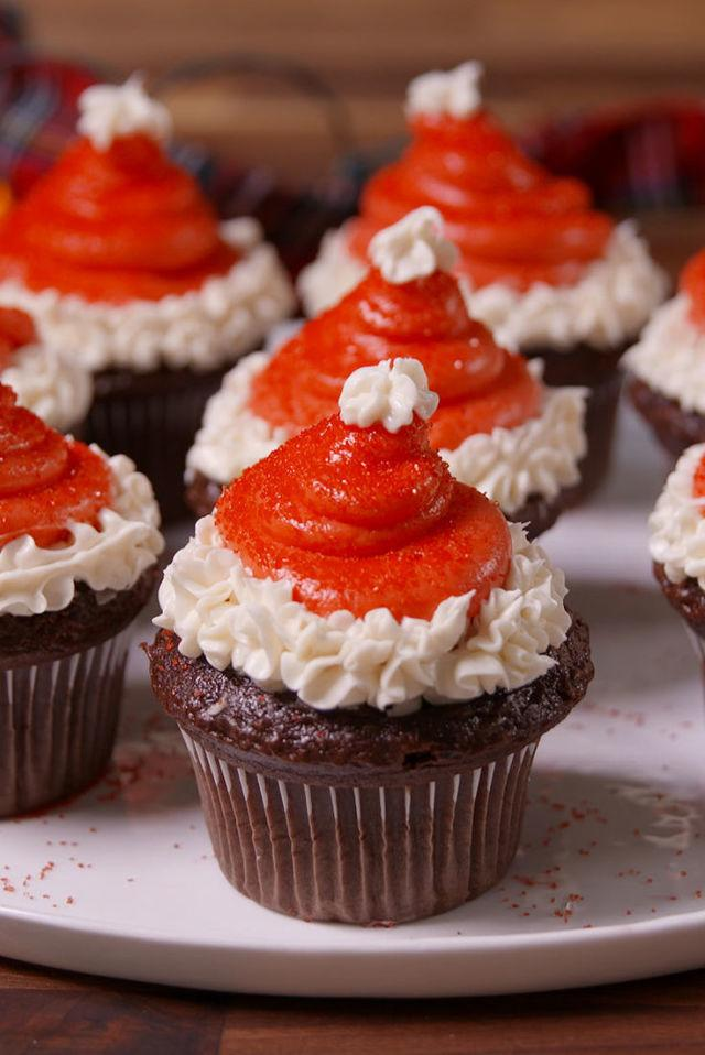"""<p><span>Not a big icing fan? Swap out the piped cream cheese frosting for a cored strawberry and a little whipped cream. </span></p><p><em><a rel=""""nofollow"""" href=""""http://www.delish.com/cooking/recipe-ideas/recipes/a50541/santa-hat-cupcakes-recipe/"""">Get the recipe from Delish »</a></em><span></span></p>"""
