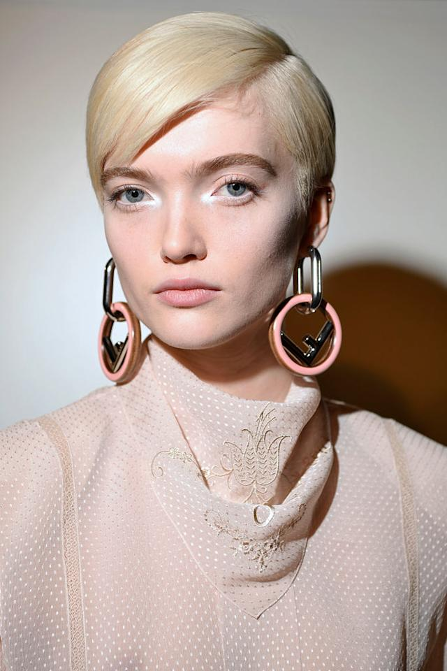 <p>Pink and silver hoop earrings at the Fendi FW18 show. (Photo: Getty Images) </p>