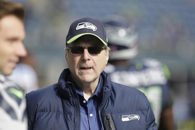Seattle Seahawks owner Paul Allen stands on the sidelines before an NFL football game against the Tennessee Titans, Sunday, Oct. 13, 2013, in Seattle. (AP Photo/Elaine Thompson)