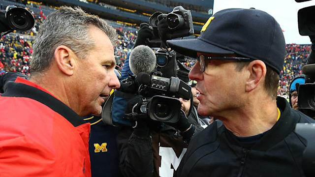 Urban Meyer and the Buckeyes face Jim Harbaugh's Wolverines on Saturday at noon ET. Harbaugh is seeking his first victory as Michigan's head coach against rival Ohio State. (Getty)