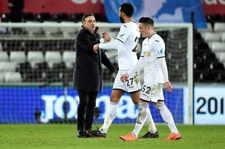 Soccer Football - FA Cup Fifth Round Replay - Swansea City vs Sheffield Wednesday - Liberty Stadium, Swansea, Britain - February 27, 2018 Swansea City manager Carlos Carvalhal shakes hands with Kyle Bartley after the match REUTERS/Rebecca Naden