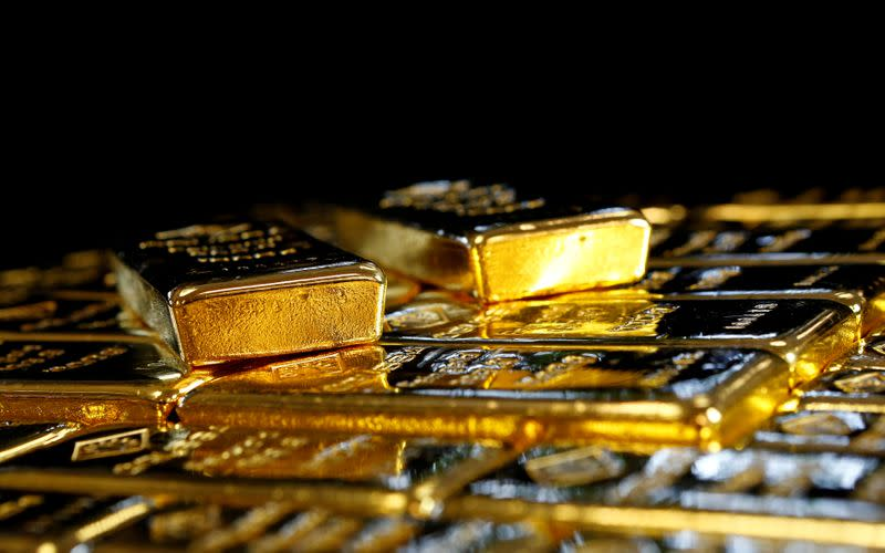 Gold slips as investors book profit ahead of Powell's speech