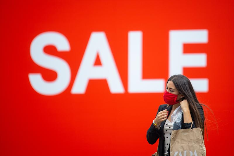 A shopper wearing a face covering on Oxford Street, London, ahead of the announcement that it will soon be mandatory to wear a face covering in shops in England.