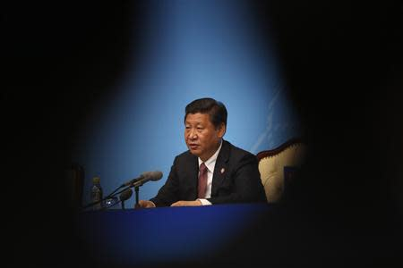 China's President Xi Jinping delivers a speech to the media during the fourth Conference on Interaction and Confidence Building Measures in Asia (CICA) summit, in Shanghai May 21, 2014. REUTERS/Carlos Barria