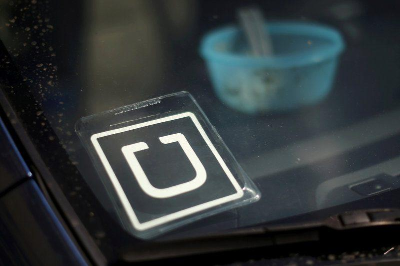 An Uber car is seen parked with the driver's lunch left on the dashboard  - Lucy Nicholson/Reuters