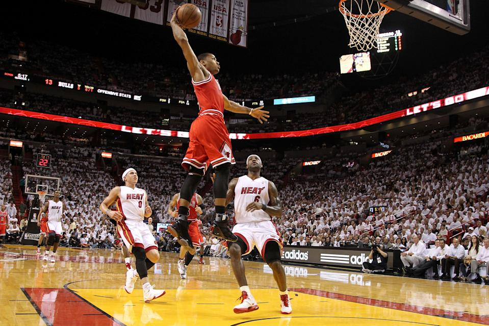 MIAMI, FL - MAY 24: Derrick Rose #1 of the Chicago Bulls dunks against LeBron James #6 and Mike Bibby #0 of the Miami Heat in Game Four of the Eastern Conference Finals during the 2011 NBA Playoffs on May 24, 2011 at American Airlines Arena in Miami, Florida. NOTE TO USER: User expressly acknowledges and agrees that, by downloading and or using this photograph, User is consenting to the terms and conditions of the Getty Images License Agreement.