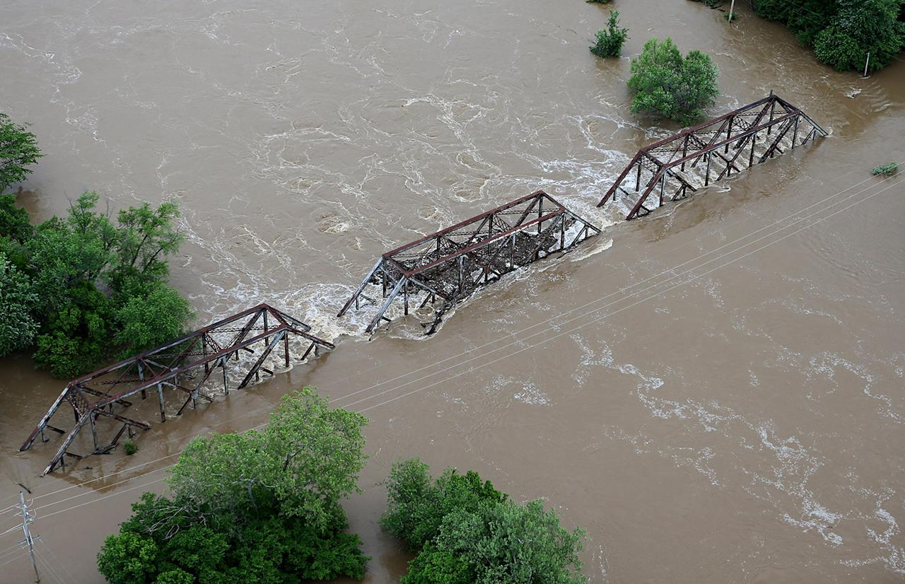 <p>Flood water from the Meramec River streams over a railroad bridge in Valley Park, Mo., May 2, 2017. (David Carson/St. Louis Post-Dispatch via AP) </p>