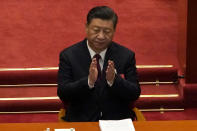 Chinese President Xi Jinping applauds during the opening session of China's National People's Congress (NPC) at the Great Hall of the People in Beijing, Friday, March 5, 2021. (AP Photo/Andy Wong)