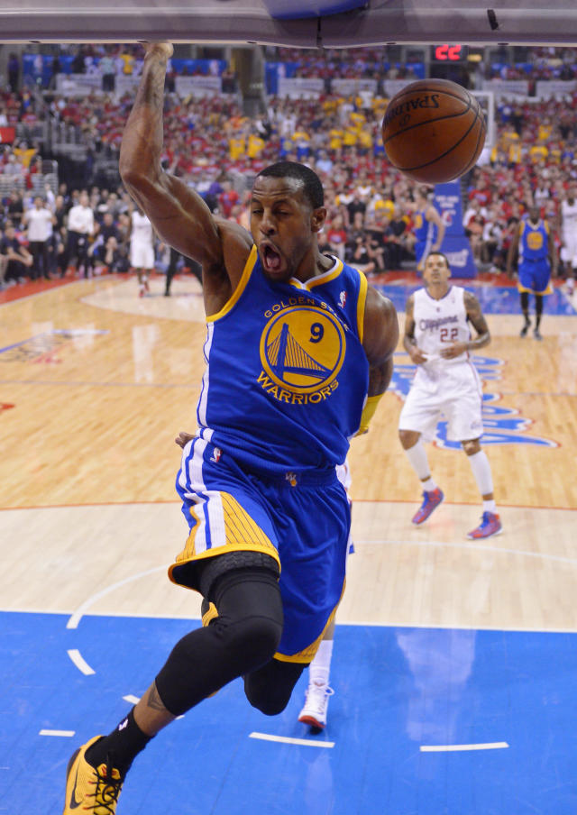 Golden State Warriors forward Andre Iguodala (9) dunks as Los Angeles Clippers forward Matt Barnes looks on during the first half in Game 7 of an opening-round NBA basketball playoff series, Saturday, May 3, 2014, in Los Angeles. (AP Photo/Mark J. Terrill)