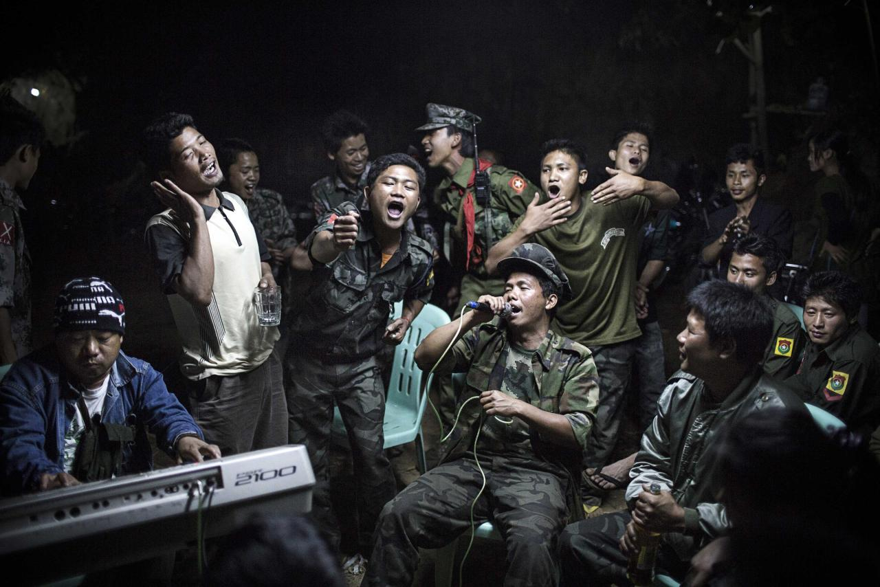 WORLD PRESS PHOTO CONTEST WINNERS. PICTURE 09 OF 19 Julius Schrank, a German photographer working for De Volkskrant won 1st Prize Daily Life Single category of the 2014 World Press Photo contest with this picture of Kachin Independence Army fighters drinking and celebrating at a funeral of one of their commanders who died the day before, in Burma, taken March 15, 2013. The prize-winning entries of the World Press Photo Contest 2014, the world's largest annual press photography contest, were announced February 14, 2014. REUTERS/Julius Schrank/World Press Photo Handout via Reuters (BURMA - Tags: MEDIA SOCIETY) NO COMMERCIAL OR BOOK SALES. NO SALES. NO ARCHIVES. FOR EDITORIAL USE ONLY. NOT FOR SALE FOR MARKETING OR ADVERTISING CAMPAIGNS. THIS IMAGE HAS BEEN SUPPLIED BY A THIRD PARTY. IT IS DISTRIBUTED, EXACTLY AS RECEIVED BY REUTERS, AS A SERVICE TO CLIENTS. MANDATORY CREDIT