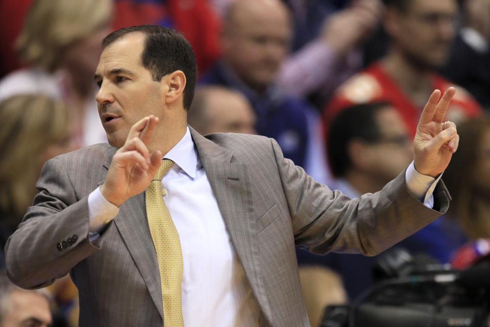 Baylor head coach Scott Drew signals a play during the first half of an NCAA college basketball game against Kansas in Lawrence, Kan., Saturday, Jan. 11, 2020. (AP Photo/Orlin Wagner)
