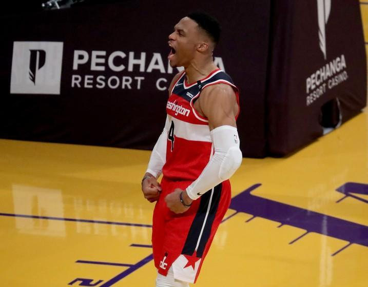 Wizards guard Russell Westbrook celebrates after scoring a basket and getting fouled against the Lakers on Feb. 23, 2021.