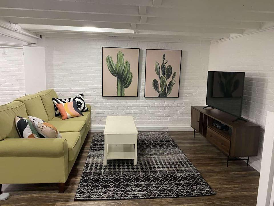 """<p>Bring a southwestern sensibility to your basement space with playful cactus framed prints and an Aztec-inspired rug. In addition to offering style inspiration, this blog post will help you solve for problems like uneven floors and low ceilings.</p><p><strong>See more at <a href=""""https://iheartvegetables.com/our-basement-rennovation/"""" rel=""""nofollow noopener"""" target=""""_blank"""" data-ylk=""""slk:I Heart Vegetables"""" class=""""link rapid-noclick-resp"""">I Heart Vegetables</a>. </strong></p><p><a class=""""link rapid-noclick-resp"""" href=""""https://go.redirectingat.com?id=74968X1596630&url=https%3A%2F%2Fwww.walmart.com%2Fip%2FPurple-Cactus-II-Print-Wall-Art-By-Grace-Popp%2F368656331&sref=https%3A%2F%2Fwww.redbookmag.com%2Fhome%2Fg36061437%2Fbasement-ideas%2F"""" rel=""""nofollow noopener"""" target=""""_blank"""" data-ylk=""""slk:SHOP CACTUS WALL ART"""">SHOP CACTUS WALL ART</a></p>"""