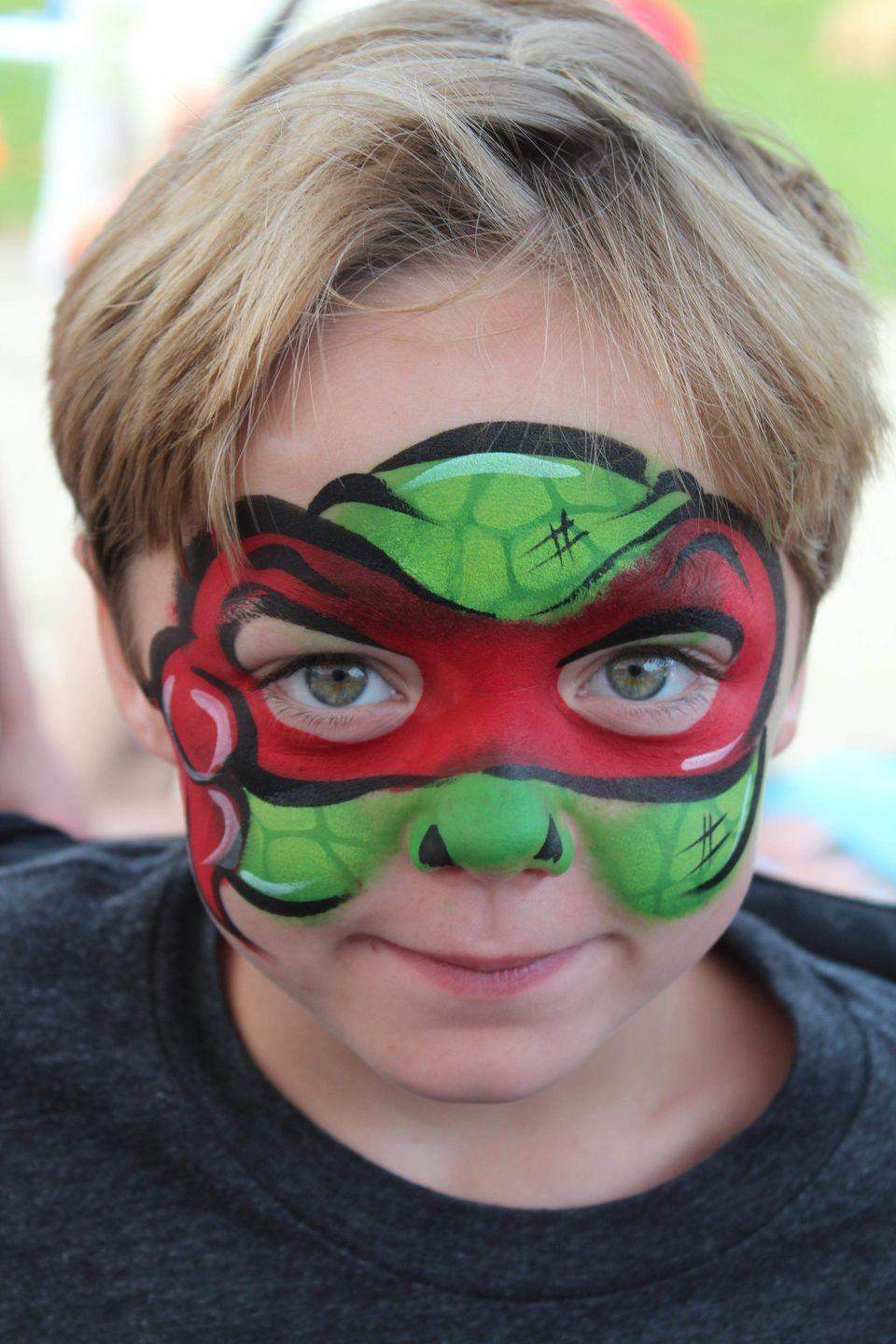 "<p>Switch up the color of the mask to match his favorite Ninja Turtle — and then add some green and black paint to finish off the look, no nun chucks required.</p><p><em><a href=""http://www.fancifulfaces.com/"" rel=""nofollow noopener"" target=""_blank"" data-ylk=""slk:See more at Fanciful Faces »"" class=""link rapid-noclick-resp"">See more at Fanciful Faces »</a></em></p>"