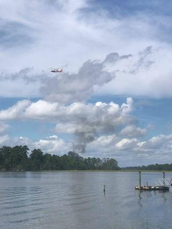 Smoke rises at the site of a F-35 fighter jet crash in Beaufort, South Carolina, U.S., September 28, 2018 in this still image obtained from social media. KENSLEY MINCEY CROSBY/via REUTERS