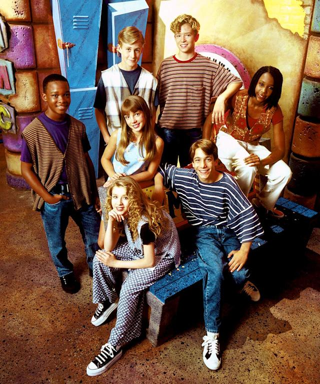 "<em>The All-New Mickey Mouse Club</em>, clockwise from far left: Marque ""Tate"" Lynch, Ryan Gosling, Justin Timberlake, Nita Booth, T.J. Fantini, Christina Aguilera, Britney Spears, center. (Photo: Walt Disney Co./Courtesy Everett Collection)"