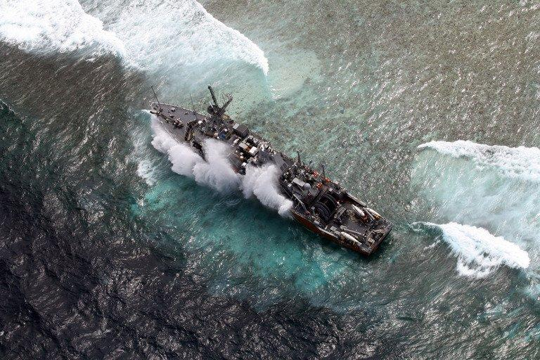 Aerial shot on January 19, 2013 of a US Navy minesweeper trapped on the Tubbataha reef in the Philippines