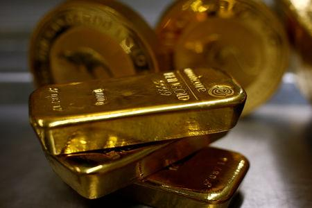 FILE PHOTO: Gold bars are stacked in safe deposit boxes room of the ProAurum gold house in Munich