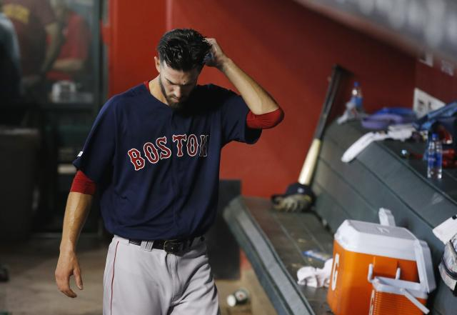 Boston Red Sox starting pitcher Rick Porcello paces in the dugout after being pulled from a baseball game during the fifth inning against the Arizona Diamondbacks Friday, April 5, 2019, in Phoenix. (AP Photo/Ross D. Franklin)