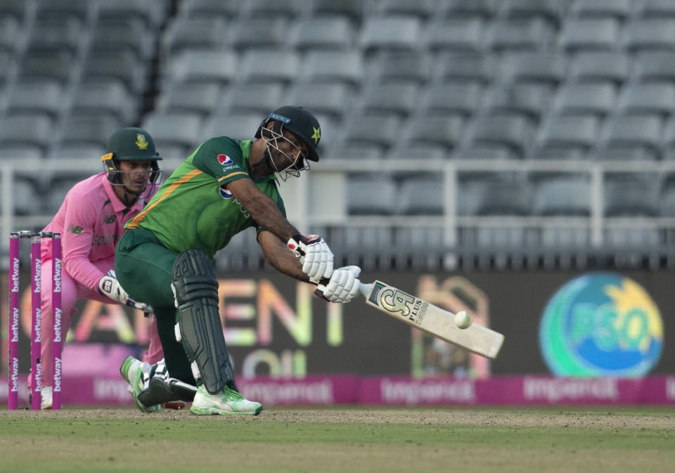 Pakistan's batsman Fakhar Zaman, right, plays a shot as South Africa's wicketkeeper Quinton de Kock watches on during the second One Day International cricket match between South Africa and Pakistan at the Wanderers stadium in Johannesburg, South Africa, Sunday, April 4, 2021. (AP Photo/Themba Hadebe)