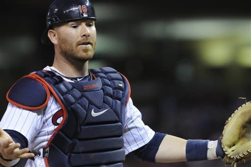 Minnesota Twins catcher Ryan Doumit reacts when he can't spot the pop foul in the lights off the bat of Tampa Bay Rays' Evan Longoria in the eighth inning of a baseball game Saturday, Aug. 11, 2012 in Minneapolis. The Rays won 4-2. (AP Photo/Jim Mone)