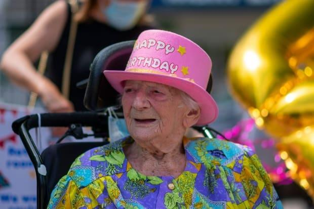 Ann Konkel of Hamilton dons a pink birthday hat for her 106th. She hopes to receive a birthday card for every year of her life. (Bobby Hristova/CBC - image credit)