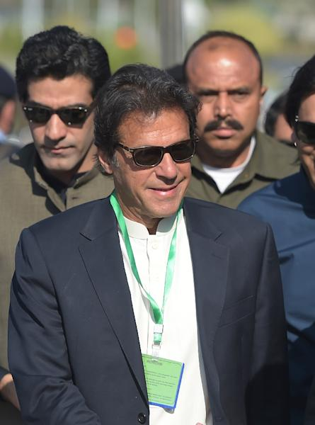 Lawyers for Pakistani cricketer-turned-opposition-leader Imran Khan argue the onus is on Sharif to prove his relatives did not engage in money laundering (AFP Photo/AAMIR QURESHI)