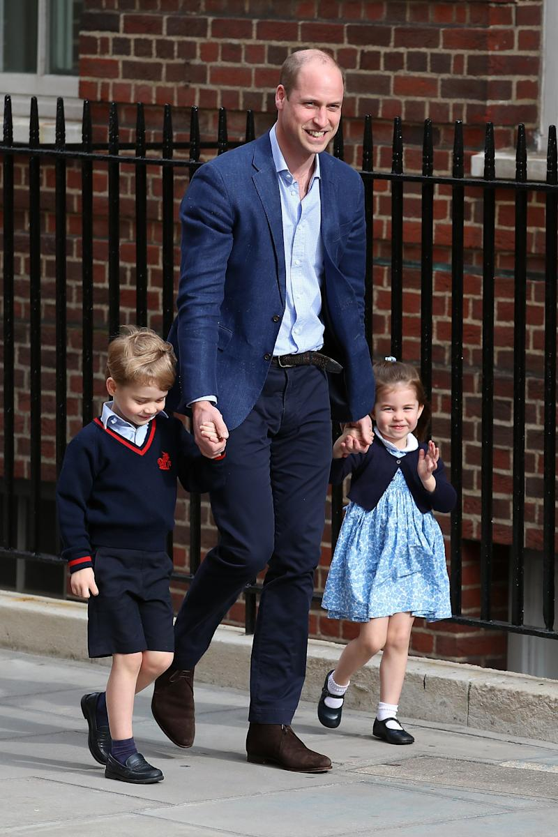 Prince William arrives at St. Mary's Hospital with Prince George and Princess Charlotte to see the new baby. (Neil Mockford via Getty Images)