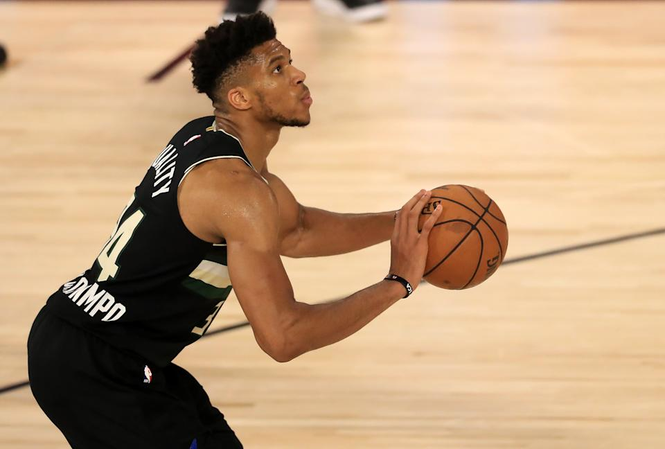Giannis Antetokounmpo #34 of the Milwaukee Bucks shoots the ball during the third quarter against the Miami Heat in Game Two of the Eastern Conference Second Round.
