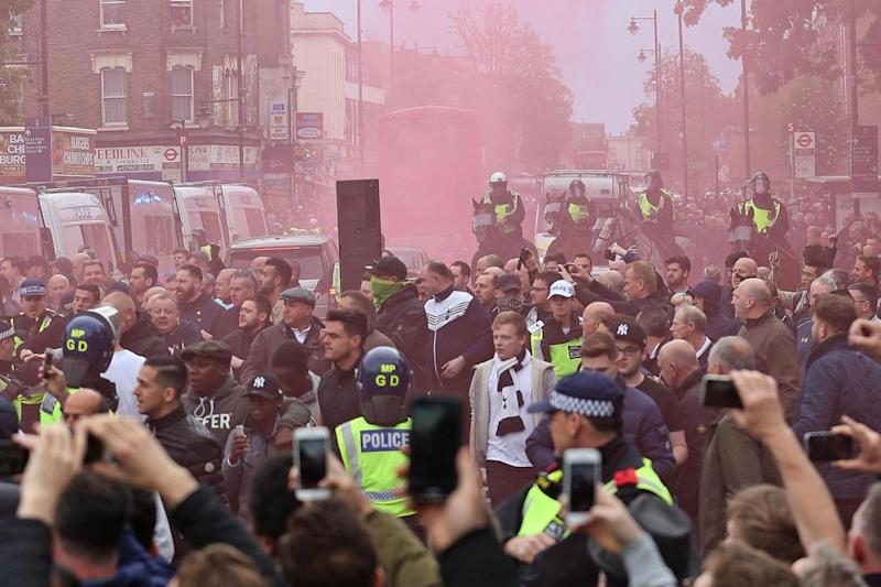 Heated: Fans set of flares, filling the north London roads with coloured smoke (Rex Features)