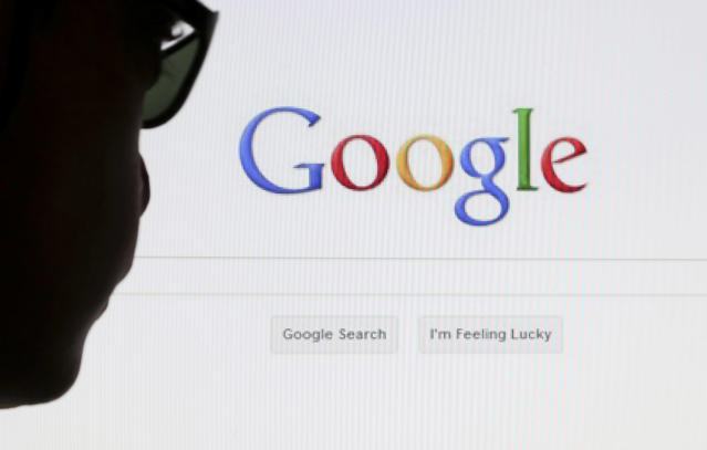 A computer user poses in front of a Google search page. Photo: REUTERS/Francois Lenoir