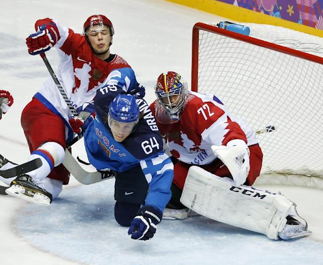 Russia defenseman Alexei Yemelin, left, and Finland forward Mikael Grandlund collide in the crease against Russia goaltender Semyon Varlamov in the third period of a men's quarterfinal ice hockey game at the 2014 Winter Olympics, Wednesday, Feb. 19, 2014, in Sochi, Russia