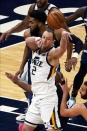 Utah Jazz's Joe Ingles (2) gets a pass off as Minnesota Timberwolves' Karl-Anthony Towns defends in the first half of an NBA basketball game, Monday, April 26, 2021, in Minneapolis. (AP Photo/Jim Mone)